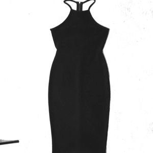 formfitting black dress with revealing back